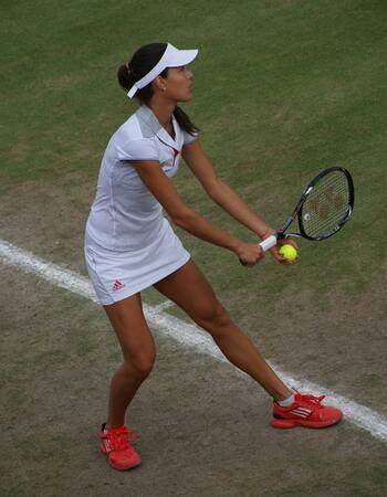 Tennis girl on grass court